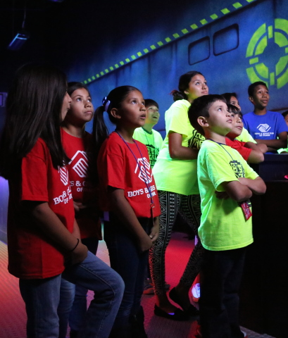 Photo courtesy of PharrNOW. To celebrate its first location in The Rio Grande Valley, Main Event Entertainment provided a sneak preview of its new center and a charitable gift of $5,000 to the Boys & Girls Club of Pharr on August 5. (Shown left to right) Isabella Sanchez, Alejandra Navarro, Alondra Navarro, Marcus Zamora, Joshua Olivarez, Bertha Cantu, Donovan De La Garza (behind Bertha), Alyssa Luna and Robert Mata all watch a video to prepare for their first game in the center's two-story laser tag court. (Photo: Business Wire)