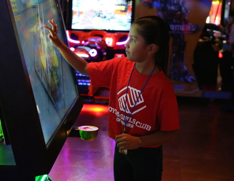 Photo courtesy of PharrNOW. To celebrate its first location in The Rio Grande Valley, Main Event Entertainment provided a sneak preview of its new center and a charitable gift of $5,000 to the Boys & Girls Club of Pharr on August 5. Shown here, Alondra Navarro enjoys a touch-screen game called Fruit Ninja, one of hundreds of video games located throughout the 58,000 square-foot facility. (Photo: Business Wire)