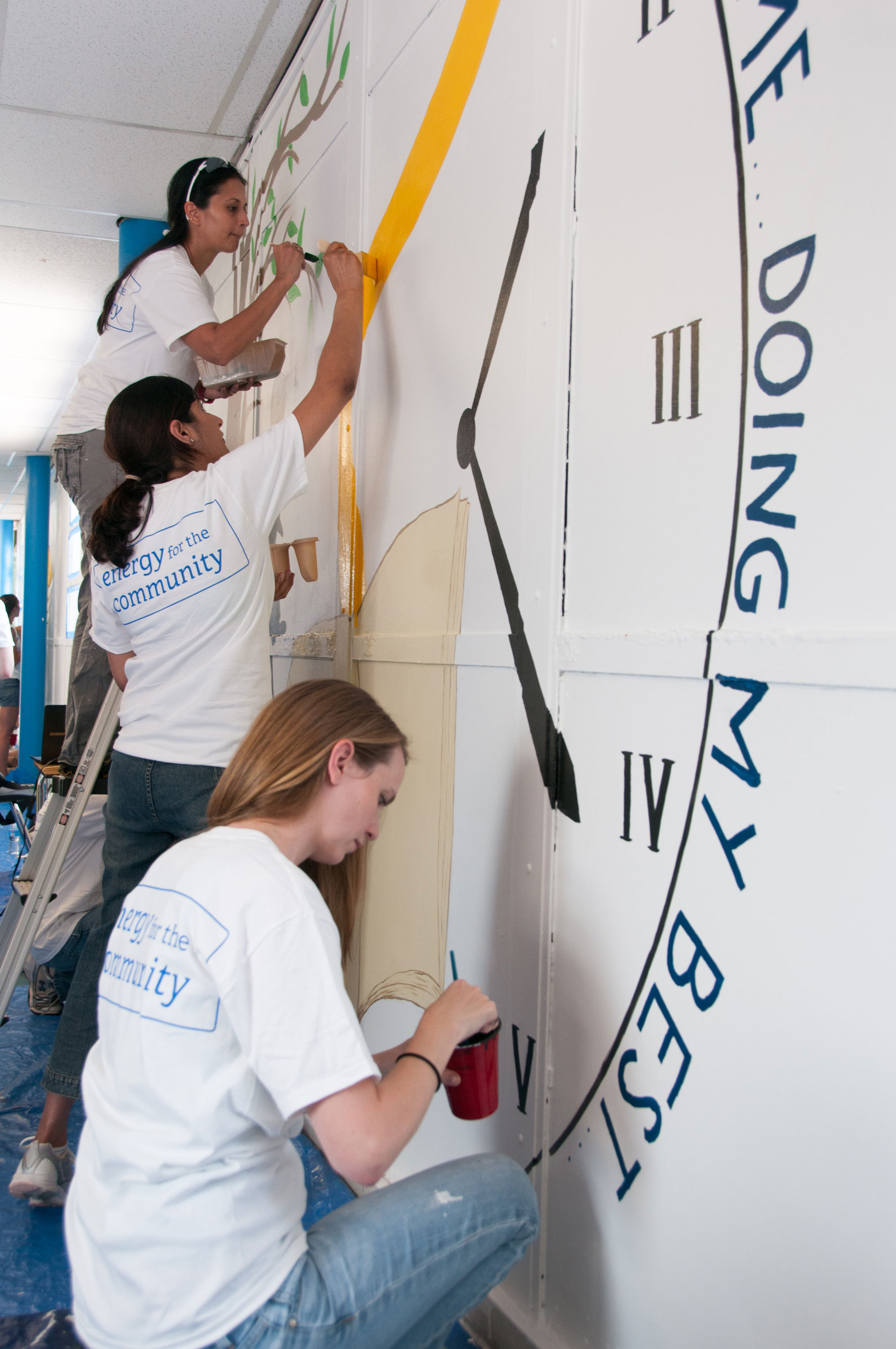Employee volunteers from Constellation paint classrooms at the Crossroads School in Baltimore, on August 5, 2014. Over 100 Constellation employees participated in the school makeover event to clean and prepare classroom space for the school year. (Photo: Business Wire)