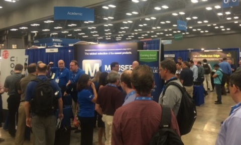 Attendees at the NIWeek design conference in Austin crowd around the exhibit of Mouser Electronics to learn more about the upcoming release of Mouser's MultiSIM BLUE, a free circuit design tool for engineers. The global distributor is collaborating with National Instruments on the powerful new tool. (Photo: Business Wire)