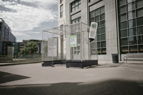 """Don't be a lab rat"" cage sits outside the Denver Public Library. (Photo: Business Wire)"