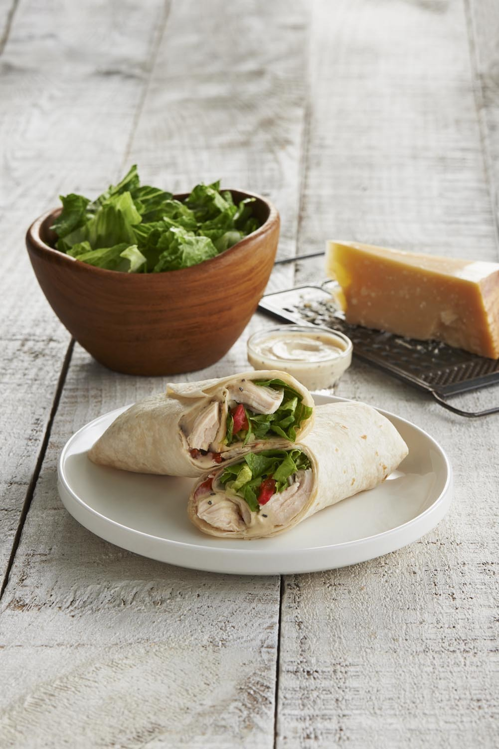 Caribou Coffee introduces healthier-for-you snacks and meal options, including this Chicken Caesar Wrap. (Photo: Business Wire)