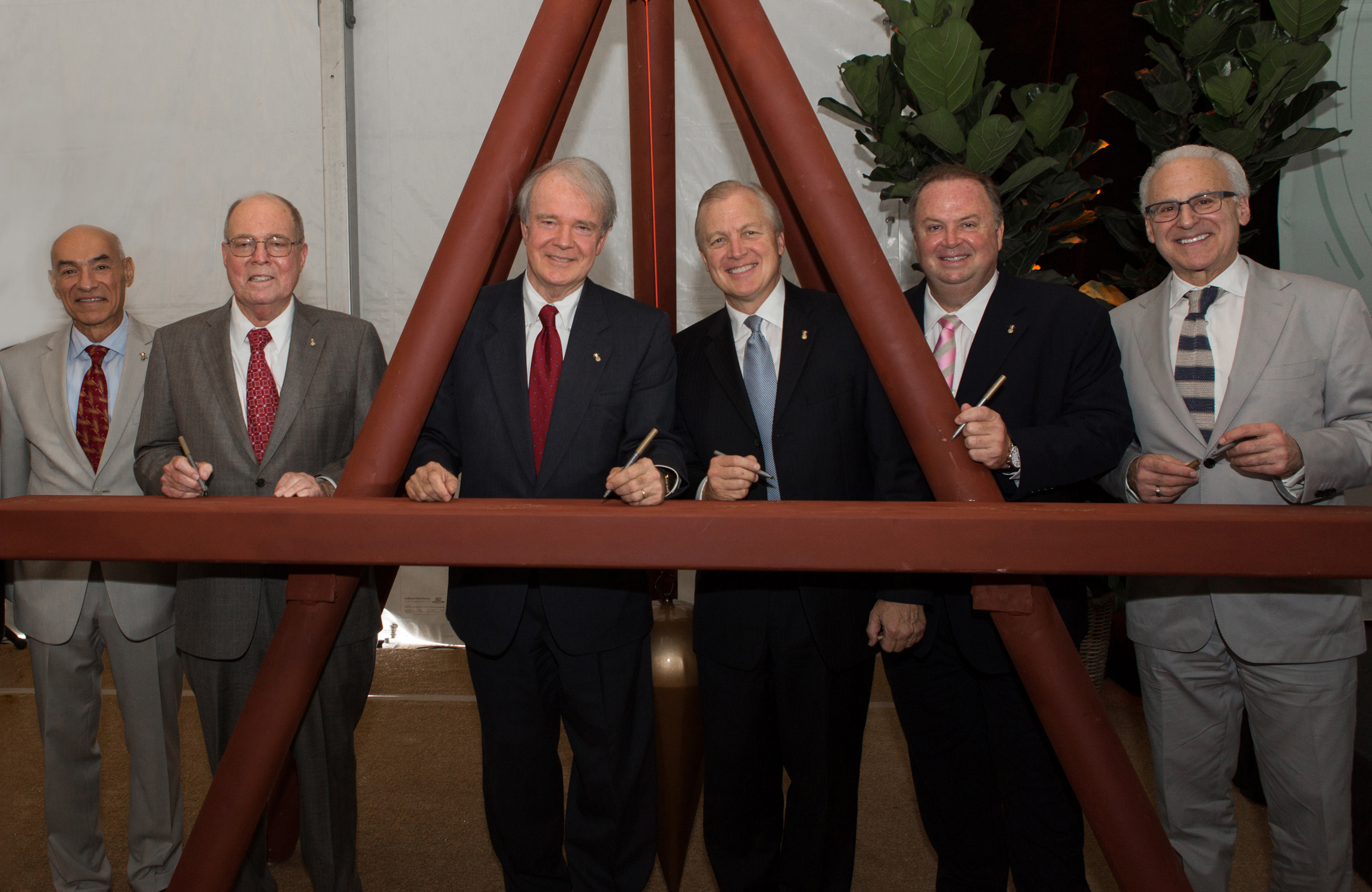 Miami Cancer Institute: Signing the installation art are, from left, Bill Banchs, CEO of Baptist Health South Florida Foundation, Lawrence Kahn, board member of Baptist Hospital of Miami, Brian Keeley, president and CEO of Baptist Health South Florida, The Rev. Dr. William White, chairman of the board of Baptist Health South Florida, Wayne Brackin, executive vice president and chief operating officer, Baptist Health South Florida, and Leonard Kalman, M.D., who will serve as deputy director for Miami Cancer Institute. (Photo: Business Wire)