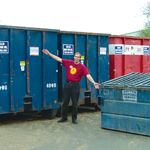Brian, Anthro's Green Team Captain, shows recycling bins on left, single garbage bin on right. (Photo: Business Wire)