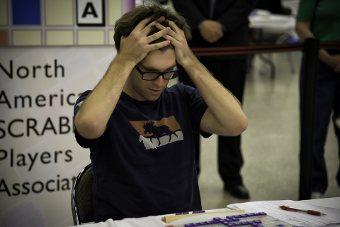 Conrad Bassett-Bouchard of Portland, OR is pictured during the 2014 National SCRABBLE Championship at the Buffalo Niagara Convention Center, Wednesday August 13. Bassett-Bouchard defeated several top SCRABBLE players during the tournament to win the champion title and a $10,000 prize. (Photo: Business Wire)