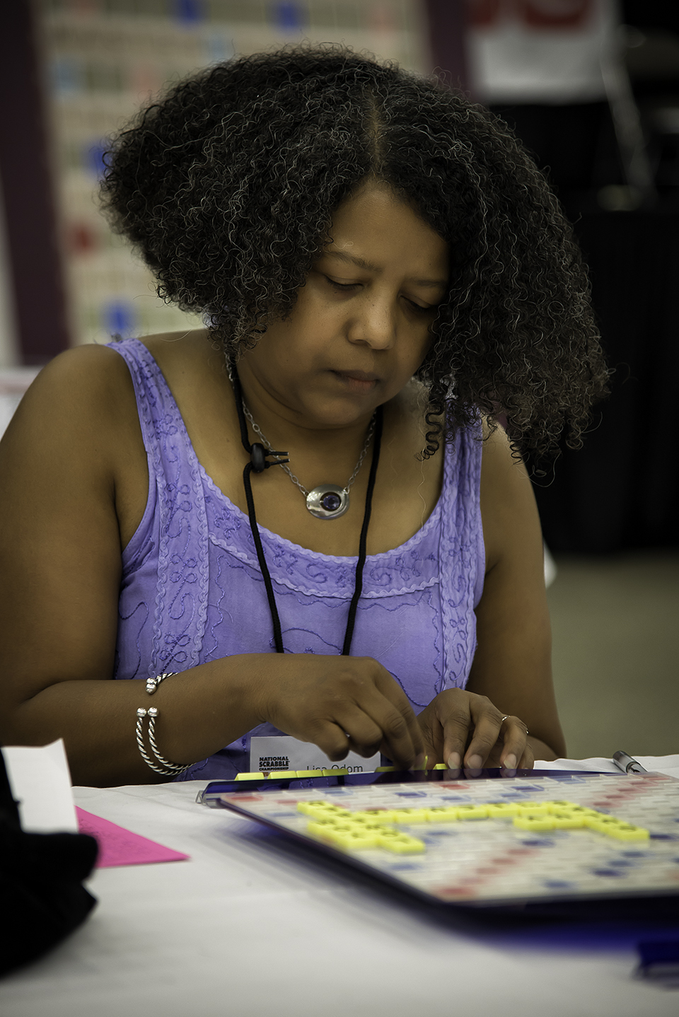 Lisa Odom from St. Louis Park, MN plays during the 2014 National SCRABBLE Championship at the Buffalo Niagara Convention Center, Wednesday August 13. Odom, the highest ranking female in Division 1, placed 12th at the tournament which gathered over 500 global players. (Photo: Business Wire)