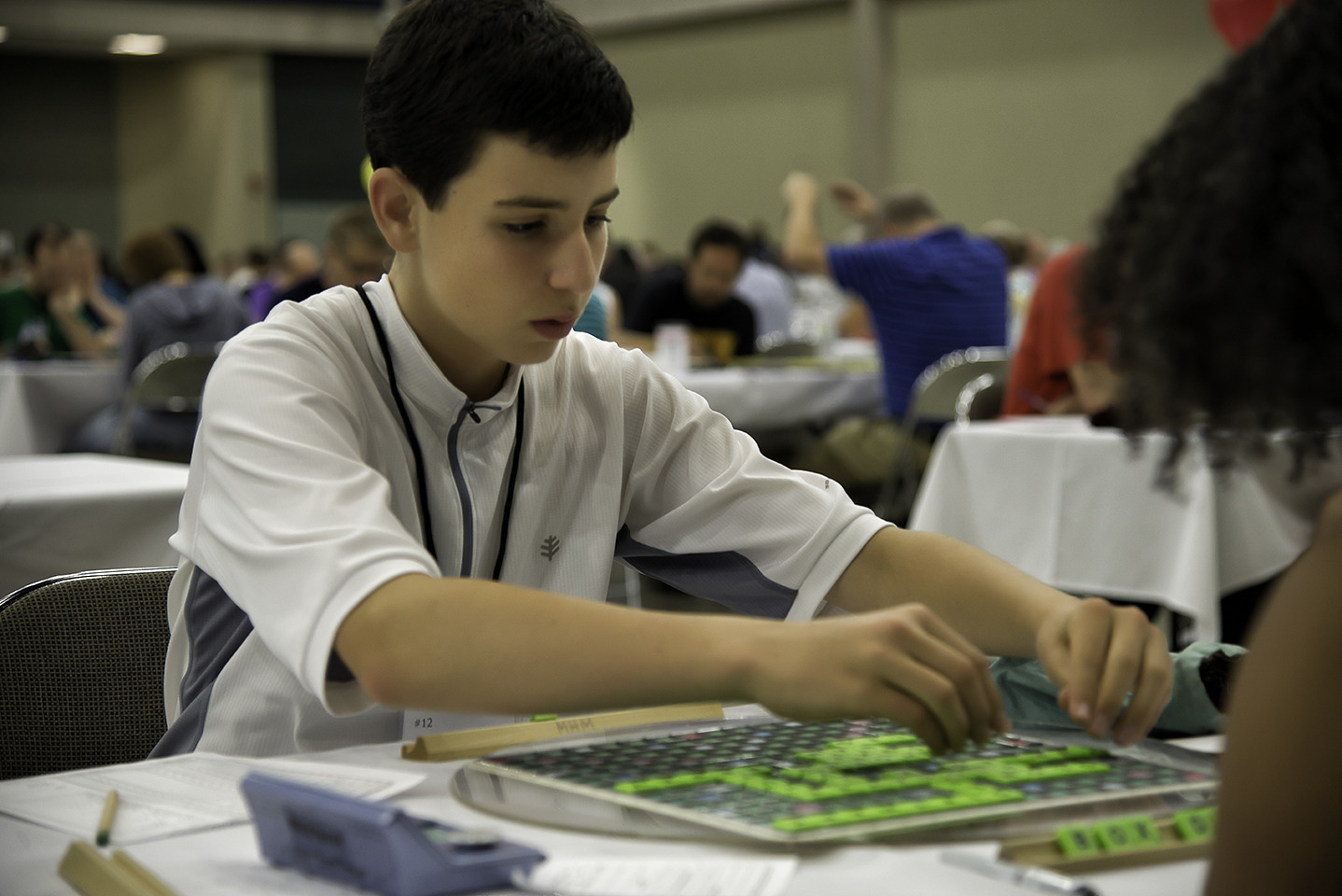 Mack Meller from Bedford, NY plays a word during the 2014 National SCRABBLE Championship at the Buffalo Niagara Convention Center, Wednesday August 13. At 14, Meller was the youngest competitor in the tournament's Division 1 and finished in 7th place. (Photo: Business Wire)