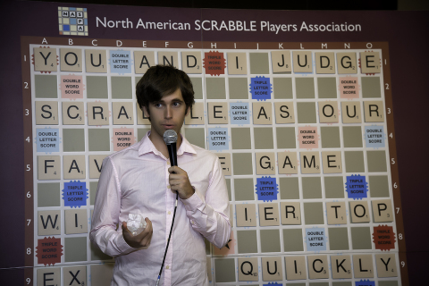 Conrad Bassett-Bouchard of Portland, OR celebrates winning the 2014 National SCRABBLE Championship at the Buffalo Niagara Convention Center, Wednesday August 13. Bassett-Bouchard defeated several top SCRABBLE players during the tournament to win the champion title and a $10,000 prize. (Photo: Business Wire)