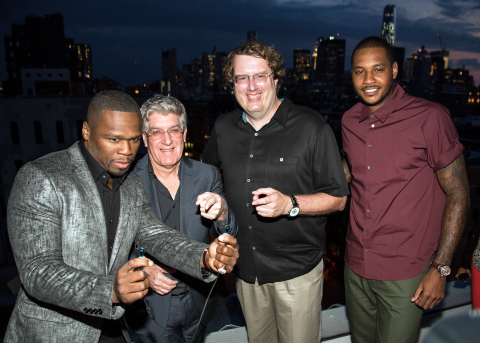 """Intel Vice President Mike Bell, SMS Audio CEO Curtis """"50 Cent"""" Jackson, SMS Audio President Brian Nohe and the New York Knicks' Carmelo Anthony with a pair of the new SMS Audio BioSport In-Ear Headphones powered by Intel. Introduced August 14 in New York, the headphones have biometric sensors in the ear piece which monitor heart rate, empowering users to collect fitness data and achieve peak physical performance. (Photo: Business Wire)"""