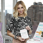 Whitney Port, designer of the fashion line Whitney Eve, showcasing the new Whitney Port for Wedding Paper Divas stationery (Photo: Getty)