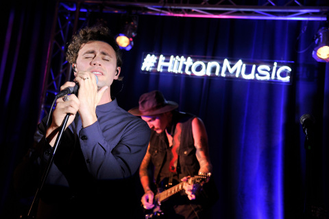 """Mikky Ekko performs his brand new single, """"Smile,"""" during an intimate concert at Hilton Times Square on August 14, 2014 in New York City. As part of its """"Our Stage. Your Story."""" campaign, Hilton Hotels & Resorts teamed up with SPIN to set the stage for exclusive concerts this summer to inspire memorable travel stories. (Photo by Stephen Lovekin/Getty Images for Hilton Hotels & Resorts)"""