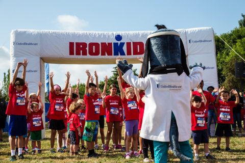 Seattle area youth, many from the Rainer Vista Boys and Girls Club, participate in stretches with UnitedHealthcare's Dr. Health E. Hound during a pre-race activities at the UnitedHealthcare IRONKIDS Seattle Fun Run which took place in Genesee Park on Saturday, August 16. (Photo Source: Trig Jones)