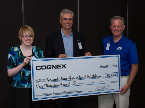 Cognex Corporation CEO Robert Willett presents a $10,000 donation to Foundation for Blind Children Chief Executive Leader Marc Ashton and Foundation for Blind Children student and Medtronic intern Emily Jepsen. (Photo: Business Wire)