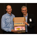 Cognex Corporation CEO Robert Willett delivers the company's one millionth shipment to Ron Wilson, Medtronic VP of Operations and GM, Tempe Campus. (Photo: Business Wire)