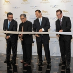 Dr. Deepak Chopra leads ribbon-cutting for the launch of Stay Well Meetings by Delos at MGM Grand Las Vegas. From left to right: Senior Vice President of Sales for MGM Resorts International, Mike Dominguez; Dr. Deepak Chopra; Delos Founder Paul Scialla; and President and COO of MGM Grand, Scott Sibella. (Photo: Business Wire)