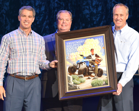 Brad Farmer, Assistant Chief of Scouts, Boy Scouts of America presents one-of-a-kind print to Polaris executives Scott Wine, Chairman and CEO (left) and Bennett Morgan, president and COO (right). (Photo: Business Wire)