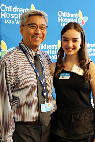 "Children's Hospital Los Angeles (CHLA) interventional cardiologist Frank Ing, MD, and his patient, Eileen Garrido. Garrido, 15, had heart surgery at CHLA in June and says she is feeling ""stronger than ever."" (Photo: Business Wire)"