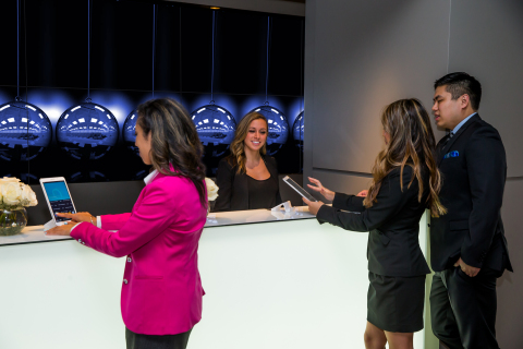 Guest are able to check-in using Samsung's Galaxy Tab S, against the backdrop of a stunning video wall.(Photo: Business Wire)