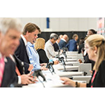 NAPE attendees register at the George R. Brown Convention Center in Houston on Thursday before heading to the show floor for a first look at the 375 exhibit booths. (Photo: Business Wire)