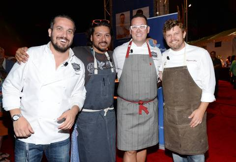 Chefs Fabio Viviani, left, Ray Garcia, Graham Elliot and Ben Ford participate in the Chase Sapphire Preferred Chef Challenge during the Ultimate Bites of L.A. at the Los Angeles Food & Wine Festival, presented by FOOD & WINE, on Thursday, Aug. 21, 2014 in Los Angeles. (Photo by Evan Agostini/Invision for Chase Sapphire Preferred/AP Images)