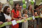 Accolade employees celebrate the opening of the company's Scottsdale office by cutting a ribbon decorated with thank you notes and kind words from clients. (Photo: Business Wire)