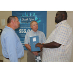 (AUGUST 22, 2014) Terrence Davis (right), Executive Director, Boys and Girls Club of Hopkinsville-Christian County, and Dave Fernandez (center), the organization's chairman of the board, talk with Ryan Dixon, Production Operator, U.S. Smokeless Tobacco Co. (USSTC), an Altria company, at a recent ACECF check presentation in Hopkinsville, Ky.