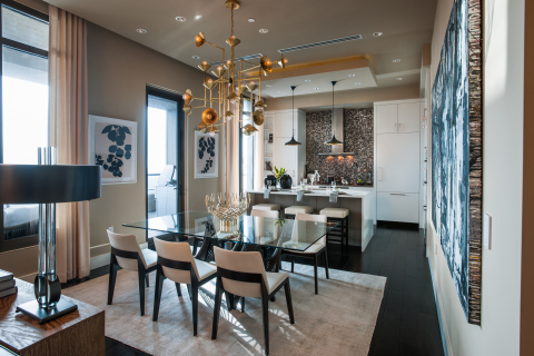 A modern motif, the kitchen showcases crisp white cabinetry, a spacious island designed to maximize storage and style, marble and stone surfaces and high-end appliances. (Photo: Business Wire)