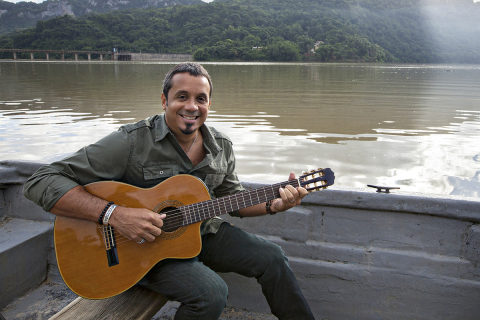 "Millo Torres during the filming of Popular's music special ""Qué lindo es Puerto Rico"" in the Lago Dos Bocas in Utuado. (Photo: Business Wire)"