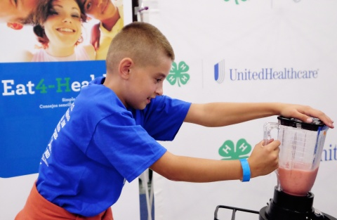 """Aidan Feely, from Central City Elementary School in Central City, creates his own healthy smoothie on the UnitedHealthcare and 4-H healthy-smoothie bike at the Nebraska State Fair on Thursday, Aug. 28, in Grand Island, Neb. The healthy smoothie bikes are part of 4-H and UnitedHealthcare's """"Eat4-Health"""" partnership aimed at tackling obesity by promoting healthy eating and lifestyles among children and families (Photo: Chad Greene)."""