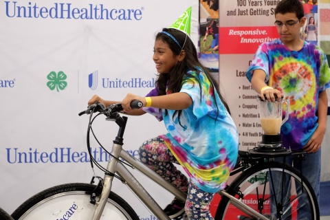 """Heydy Benitez, left, and Noah Beedles, 5th graders from Platte Valley Elementary School in Grand Island, create their own healthy smoothies on the UnitedHealthcare and 4-H smoothie bike at the Nebraska State Fair on Thursday, Aug. 28, Grand Island, Neb. The healthy smoothie bikes are part of 4-H and UnitedHealthcare's """"Eat4-Health"""" partnership aimed at tackling obesity by promoting healthy eating and lifestyles among children and families (Photo: Chad Greene)."""