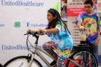 "Heydy Benitez, left, and Noah Beedles, 5th graders from Platte Valley Elementary School in Grand Island, create their own healthy smoothies on the UnitedHealthcare and 4-H smoothie bike at the Nebraska State Fair on Thursday, Aug. 28, Grand Island, Neb. The healthy smoothie bikes are part of 4-H and UnitedHealthcare's ""Eat4-Health"" partnership aimed at tackling obesity by promoting healthy eating and lifestyles among children and families (Photo: Chad Greene)."