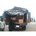 ChildFund International workers in Liberia unload emergency medical supplies delivered by humanitarian airlift to help contain the spread of the Ebola virus. (Photo: Business Wire)
