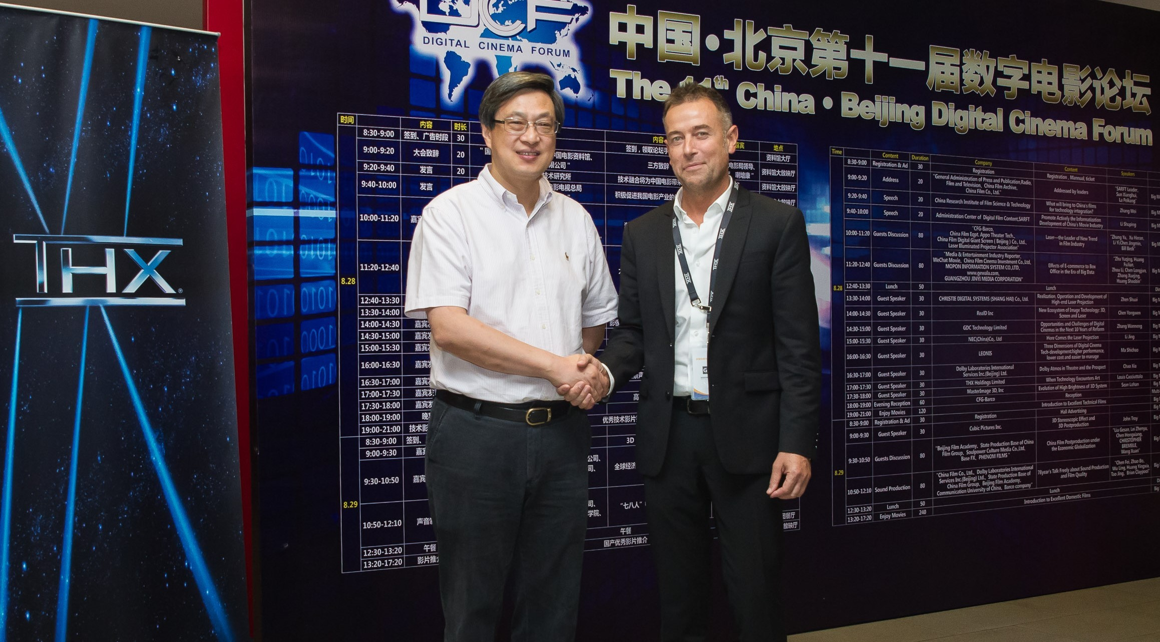Hand shake: Mr. Lin Min Jie General Manager of China Film Group's subsidiary company China Film Equipment Co. Ltd & Louis Cacciuttolo (Photo: Business Wire)