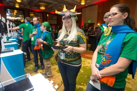 In this photo provided by Nintendo of America, Megan Mann slashes through hundreds of enemies while  ...