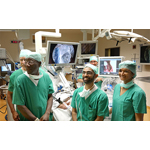 (Left to Right) The surgical team of Prof. Georges Lawson of The University Hospital Dinant Godinne-UCL Namur (Belgium), Dr. Umamaheswar Duvvuri of the University of Pittsburgh Medical Center (USA) and Dr. Magis Mandapathil of University Hospital of Marburg immediately following the use of the Flex(R) System, a first of its kind flexible robot system. (Photo: Business Wire)
