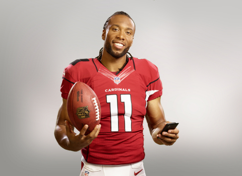 Eight-time Pro Bowler Arizona Cardinals wide receiver Larry Fitzgerald shows how easy it is to pay on his mobile phone using Visa Checkout. (Photo: Business Wire)