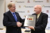 Executive Director Emeritus of the Uptime Institute and Senior Tier Certification Authority for Uptime Institute Professional Services Pitt Turner presents the first in Russia Tier III Operational Sustainability-Gold Certificate to DataSpace VP of Operations Fred Dickerman. (Photo: Business Wire)