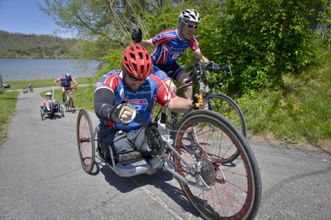 Mike Frazier gets a helping hand from Ray Clark as they tackle a hill together on the Ride 2 Recover