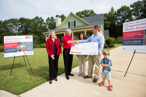 "David Meeks, the first $250,000 prize winner in Wells Fargo's ""What Makes a Home"" contest, receives the check with his family at their home in Forsyth, Georgia. Pictured (left to right): Arlene Maloney, Senior Vice President, Wells Fargo Home Mortgage; Terry Berding, Wells Fargo Home Mortgage Consultant; Melissa and David Meeks and their son, Will. (Photo: Business Wire)"