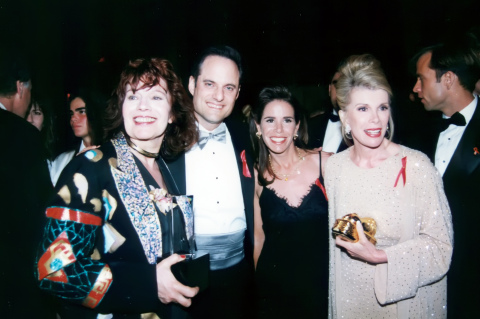 Joan Rivers Honored at AIDS Healthcare Foundation's Academy Awards Gala in 1992. L to R: AIDS advocates including PAWS/LA co-founder Nadia Sutton, AIDS Healthcare Foundation President Michael Weinstein, Melissa Rivers, and her mother, comedienne Joan Rivers, at an AHF Oscar Night Gala benefiting AHF held at the Director's Guild of America in Los Angeles in 1992. Rivers' longtime hairdresser had been a patient at AHF's Chris Brownlie AIDS Hospice in 1989, which led Rivers to become an ardent supporter of AHF and early advocate on AIDS issues. (Photo: Business Wire)