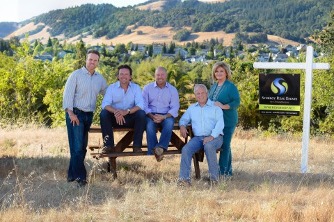 The Synergy Group at their newest development, Sky Vistas across Highway 12 from Skyhawk, where they built 512 homes in the 1990s (from left to right: Andy Christopherson, Greg Windisch, Brian Flahavan, Keith Christopherson and Brenda Christopherson) (Photo: Business Wire)