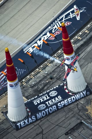 Kirby Chambliss of the United States performs during the finals for the sixth stage of the Red Bull Air Race World Championship at the Texas Motor Speedway in Fort Worth, Texas, United States on September 7, 2014. (Photo: Sebastian Marko/Red Bull Content Pool)