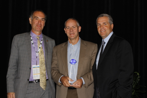 Dallas-based tripBAM CEO Steve Reynolds (middle) accepts the Business Travel Supplier Innovation Award from Business Travel News executives at the inaugural BTN Group Innovate Conference in New York on September 4, 2014. Judges at the technology-focused event honored tripBAM for its progress in helping corporations and travel agencies use automation to secure lower hotel rates. Left to Right: BTN Editorial Director David Meyer, tripBAM CEO Steve Reynolds, and BTN Group Publisher Louis Magliaro. (Photo: Business Wire)