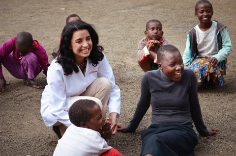 Walgreens pharmacist, Martha Morphonios, RPh, interacts with children in Tanzania, Africa as a part