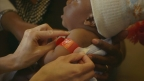 A child receives a measles vaccine at a recent clinic in Tanzania. (Photo: Business Wire)