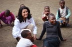 """Walgreens pharmacist, Martha Morphonios, RPh, interacts with children in Tanzania, Africa as a part of the """"Get a Shot. Give a Shot"""" campaign.  (Photo: Business Wire)"""