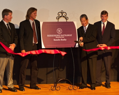 Berkshire Hathaway HomeServices Results Realty co-owners (from left) Tim St. Gordon, Jeff Perry and Joseph Doher look on as Earl Lee, CEO of HSF Affiliates LLC, cuts a ribbon commemorating the brokerage's brand transition. (Photo: Business Wire)