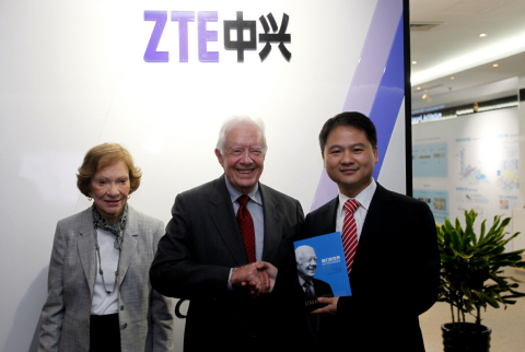 President Carter presents his book, A Call to Action, to ZTE Executive Vice President Adam Zeng (Photo: Business Wire)