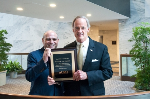 Senator Tom Carper (D-DE) receives ACRO's 2014 Legislator of the Year Award from ACRO Senior Vice President John Lewis. (Photo: Business Wire)