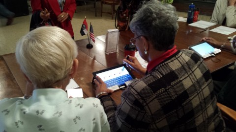 Precinct Election Workers using the EA Tablet System to check in voters. The System reduces provisional ballots and speeds the check in process at the polling place. (Photo: Business Wire)